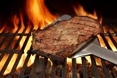 Spatula With Beef Steak On The Grill