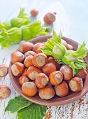 foto of cobnuts  - hazelnuts on plate and on a table - JPG