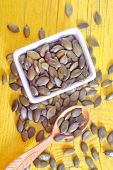 foto of fibrin  - pumpkin seed in bowl and on a table - JPG