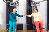 Happy Old Women At The Gym Touching By Palms
