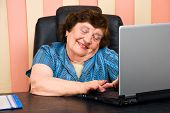 Elderly Office Woman Havinf Fun On Laptop