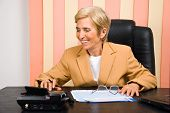 Laughing Senior Business Woman Using Calculator