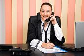 Business Woman By Telephone Taking Notes