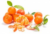 Mandarins Or Clementines With Segments With Leaves