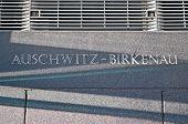 Auschwitz - Birkenau, Message Closeup On Stone Wall