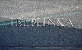 Treblinka Text Closeup On Stone Wall
