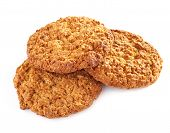 stock photo of baked raisin cookies  - Several oatmeal cookies in a stack on a white background - JPG