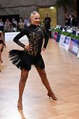 Female latin dancer dancing during competition