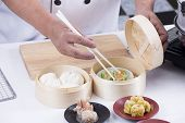 Chef Using Chopsticks Hold Chinese Dumpling