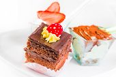 Delicious Slice Of Chocolate Cake With Cream And Candy To Sugar