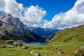 pic of lagos  - Lago di Fedaia and Marmolada in the Dolomites mountains of northern Italy - JPG