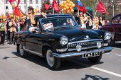 Old-fashioned car GAZ-21 participates in parade
