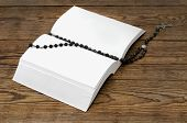 Open Blank Book With A Rosary