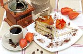 A Piece Of Sponge Cake And A Cup Of Coffee