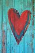 Vintage Valentine heart on a weathered wooden door.