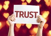 Trust card with heart bokeh background
