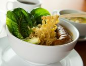 stock photo of korean  - Closeup of Korean noodle soup served with sausage and lettuce - JPG