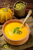 Homemade Autumn Butternut Squash Soup rustic wooden table