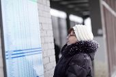 Woman Looks At Train Schedule