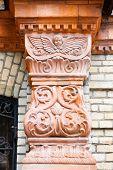 Detail Of An Old Pillar On Facade