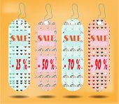 Three hanging tags with text Sale  , tags made from pattern - hearts, umbrellas