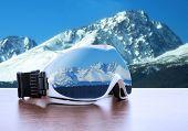 Ski glasses against mountains