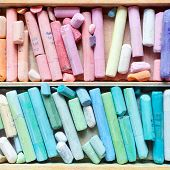 Professional Pastel Crayons In Wooden Artist Box Closeup, Top View.
