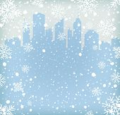 Background with snow flakes and city silhouette