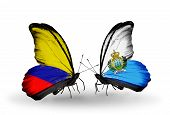 Two Butterflies With Flags On Wings As Symbol Of Relations Columbia And San Marino
