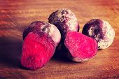 Fresh raw beetroots on wooden table.