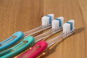 Row Of Three New Tooth Brushes