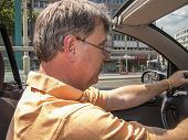 Man Driving His Cabrio At A Sunny Day