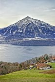 Niesen Mountain And Lakeview Near Thun Lake In Swiss Alps In Winter