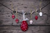 Many Red And White Easter Eggs And One Big Egg Hanging On Line Frame
