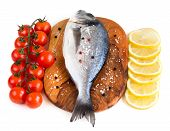 Fresh Dorado Fish, Lemon And Tomatoes