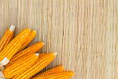 Dry Corn On Thai Traditional Mat With Copyspace