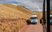 Tour Bus Along The Cusco-puno Road, Peru