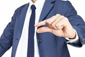 Businessman With Pinch Hand Gesture Isolated On White Background