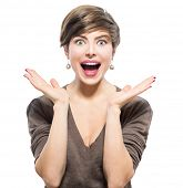 Surprised Woman. Young emotional beauty with short hairstyle looking excited, throwing up hands isolated on white background. Girl with shot brown hair expressing positive emotions, smile with teeth.