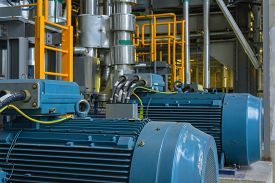 picture of electric station  - Electric Industrial generator inside power plant closeup - JPG