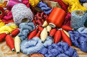 image of silk worm  - Multicolored silk fabric weaving is seen in rural Thailand - JPG