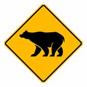 stock photo of grizzly bear  - A road sign provides a warning about grizzly bears near the freeway - JPG