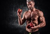 image of men underwear  - a handsome young muscular sports man holding a red pepper - JPG