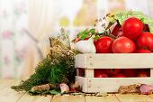 picture of crate  - Tomatoes and dill in crate on table - JPG