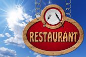 picture of food chain  - Wooden sign with frame white plate with silver cutlery and text restaurant - JPG