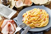 pic of carbonara  - Delicious pasta carbonara on a gray plate - JPG