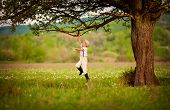 stock photo of farmer  - cute little farmer boy playing under an old tree - JPG