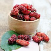 picture of mulberry  - Fresh mulberry in wooden bowl on wooden background - JPG