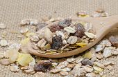 image of sackcloth  - Oat flakes in wooden spoon on sackcloth background - JPG