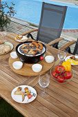 stock photo of grilled sausage  - The grill party at pool with sausages and chicken - JPG